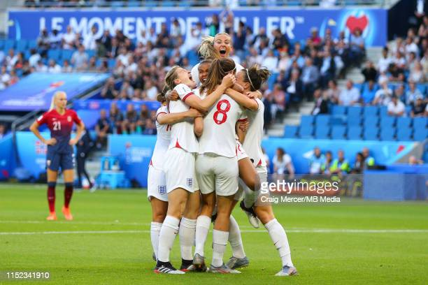 Jill Scott of England celebrates scoring the opening goal with teammates during the 2019 FIFA Women's World Cup France Quarter Final match between...