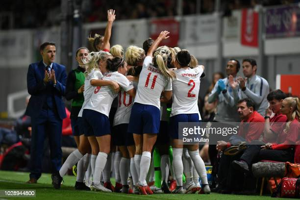 Jill Scott of England celebrates scoring the second goal during the Women's World Cup qualifier between Wales Women and England Women at Rodney...
