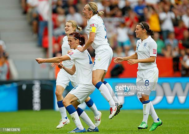 Jill Scott of England celebrates with Faye White and Fara Williams after Scott's goal against France during the FIFA Women's World Cup 2011 Quarter...