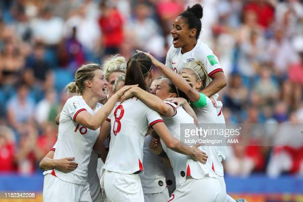 Jill Scott of England celebrates with her team mates after scoring a goal to make it 01 during the 2019 FIFA Women's World Cup France Quarter Final...