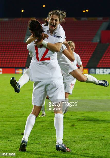 Jill Scott of England celebrates with team mate Karen Carney after scoring the winning goal in extra time during the UEFA Women's Euro 2009 SemiFinal...