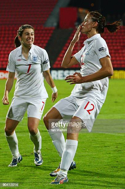 Jill Scott of England celebrates with team mate Karen Carney after scoring the winning goal during the UEFA Women's Euro 2009 SemiFinal match between...
