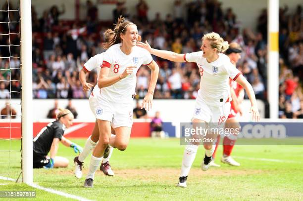 Jill Scott of England celebrates with teammate Ellen White after scoring her team's second goal during the International Friendly between England...