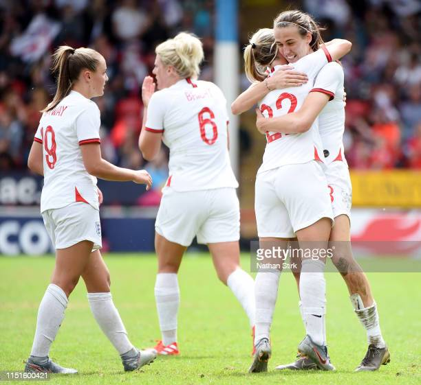 Jill Scott of England celebrates with teammates after scoring her team's second goal during the International Friendly between England Women and...
