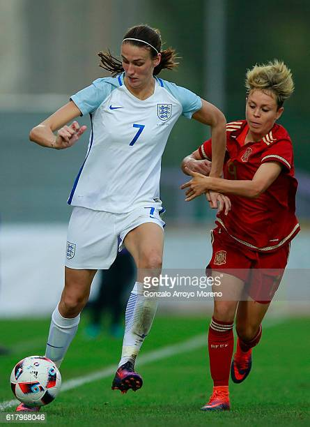 Jill Scott of England competes for the ball with Amanda Sampedro of Spain during the International Friendly match between Spain and England Women...