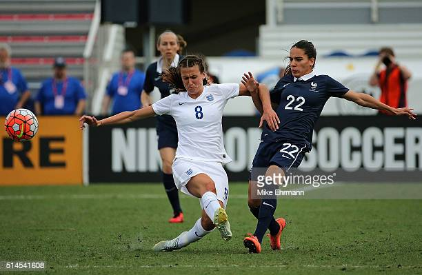 Jill Scott of England fight for the ball with Amel Majri of France during a match against in the 2016 SheBelieves Cup at FAU Stadium on March 9 2016...
