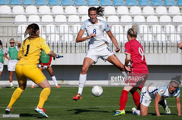 Jill Scott of England in action against Marija Radojicic and goalkeeper Susanne Nilsson of Serbia of during the UEFA Women's European Championship...