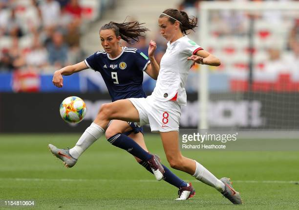 Jill Scott of England is challenged by Caroline Weir of Scotland during the 2019 FIFA Women's World Cup France group D match between England and...
