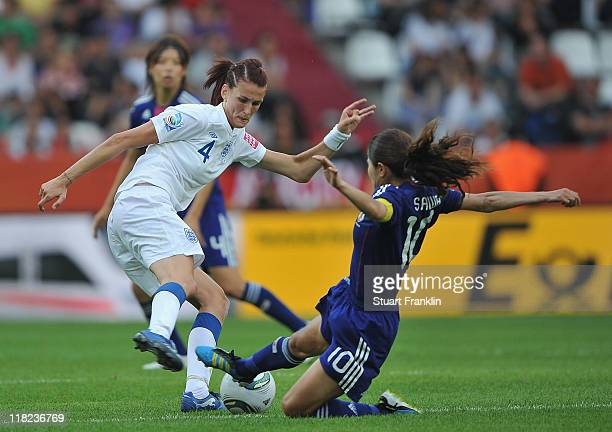 Jill Scott of England is challenged by Homare Sawa of Japan during the FIFA Women's World Cup 2011 group B match between England and Japan at the...