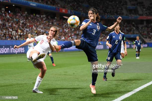 Jill Scott of England is closed down by Aya Sameshima of Japan during the 2019 FIFA Women's World Cup France group D match between Japan and England...