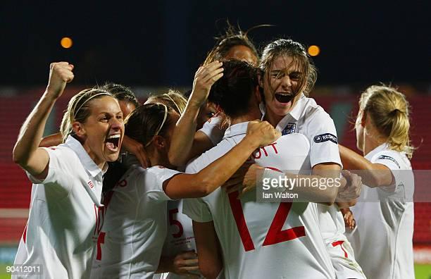 Jill Scott of England is congratulated by team mates after scoring the winning goal during the UEFA Women's Euro 2009 Semi-Final match between...