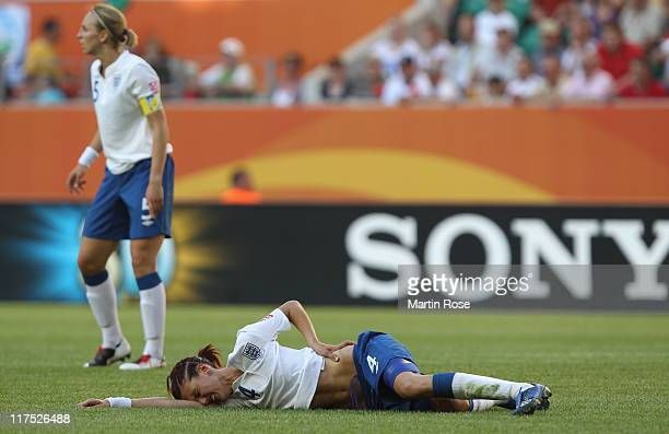 Jill Scott of England lies injured on the field during the FIFA Women's World Cup 2011 Group B match between Mexico and England at Wolfsburg Arena on...