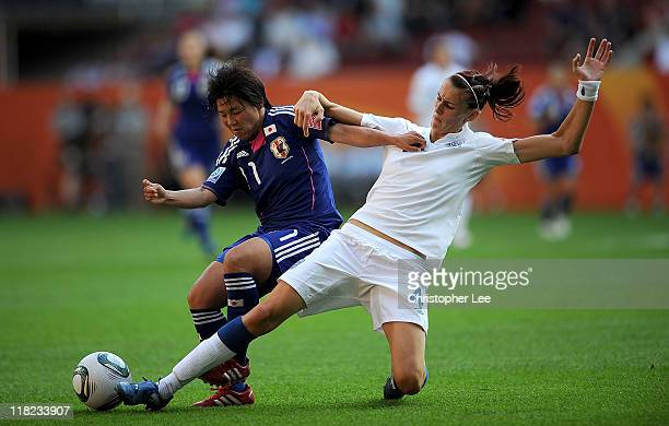 Jill Scott of England slides in to stop Shinobu Ohno of Japan during the FIFA Womens World Cup Group B match between England and Japan in Augsburg...