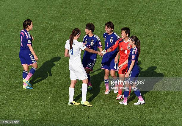Jill Scott of England sportingly congratulates the Japan players at the end of the FIFA Women's World Cup 2015 Semi Final match between Japan and...