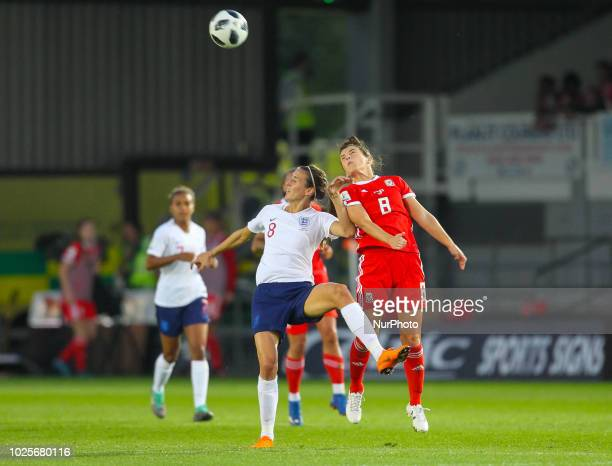 Jill Scott of England Women and Angharad James of Wales Women challenge for the ball during 2019 FIFA Women's World Cup Group 1 qualifier between...
