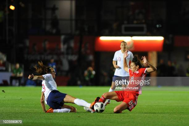 Jill Scott of England Women battles with Angharad James of Wales Women during the FIFA Women's World Cup Qualifier match between Wales and England at...