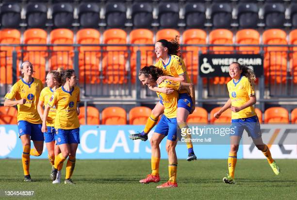 Jill Scott of Everton celebrates with Nicoline Sorensen and team mates after scoring their side's third goal during the Barclays FA Women's Super...