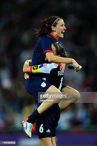 Jill Scott of Great Britain celebrates victory with teammate Casey Stoney of Great Britain after the Women's Football first round Group E Match...