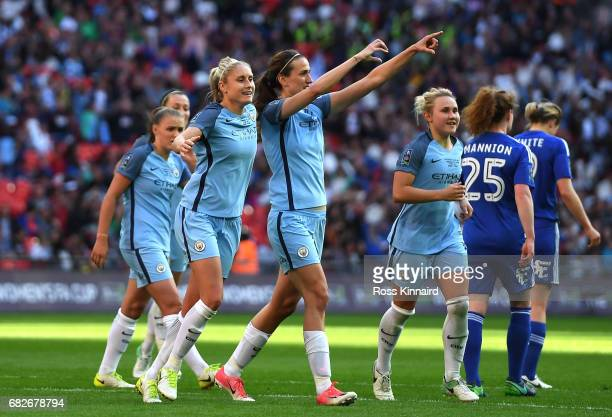 Jill Scott of Manchester City celebrates scoring her sides fourth goal with Isobel Christiansen of Manchester City and Steph Houghton of Manchester...