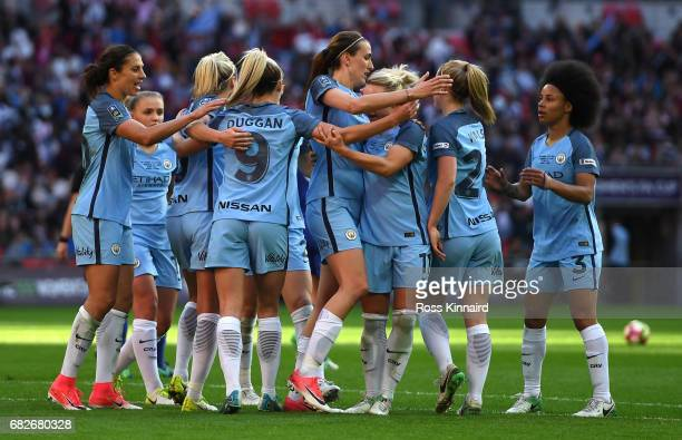 Jill Scott of Manchester City celebrates scoring her sides fourth goal with her Man City team mates during the SSE Women's FA Cup Final between...