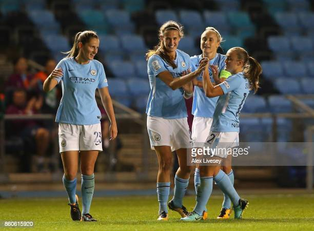 Jill Scott of Manchester City celebrates with team mates after scoring their second goal during the UEFA Women's Champions League match between...