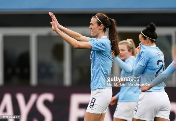 Jill Scott of Manchester City celebrates with team mates socially distant during the Barclays FA Women's Super League match between Manchester City...