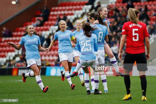 Jill Scott of Manchester City celebrates with teammates after scoring her team's third goal during the Women's FA Cup Fourth Round match between...