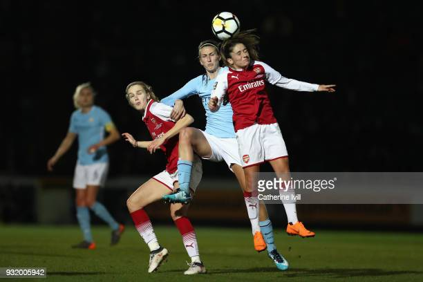 Jill Scott of Manchester City competes for a header with Danielle Van de Donk of Arsenal whilst also under pressure from Vivianne Miedema of Arsenal...
