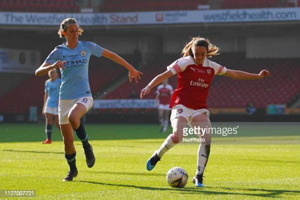 Jill Scott of Manchester City defending against Lisa Evans of Arsenal during the FA Women's Continental League Cup Final football match between...