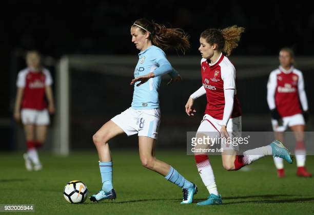 Jill Scott of Manchester City is challenged by Dominique Janssen of Arsenal during the WSL Continental Cup Final between Arsenal Women and Manchester...
