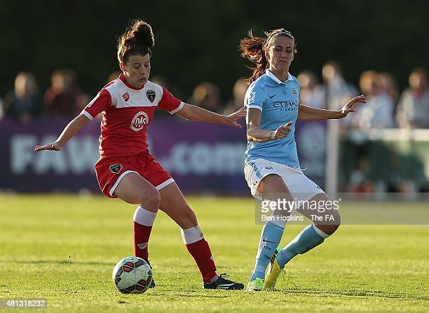 Jill Scott of Manchester City passes under pressure from Angharad James of Bristol during the WSL match between Bristol Academy Women and Manchester...