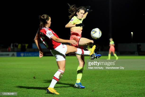 Jill Scott of Manchester City tackles Katie McCabe of Arsenal during the FA Women's Continental League Cup SemiFinal match between Arsenal Women and...
