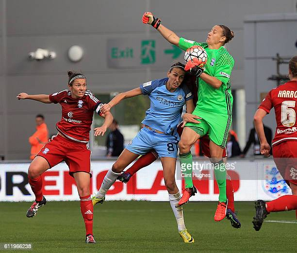 Jill Scott of Manchester City Women is beaten to the ball by AnnKatrin Berger of Birmingham City Ladies during the Continental Cup Final between...