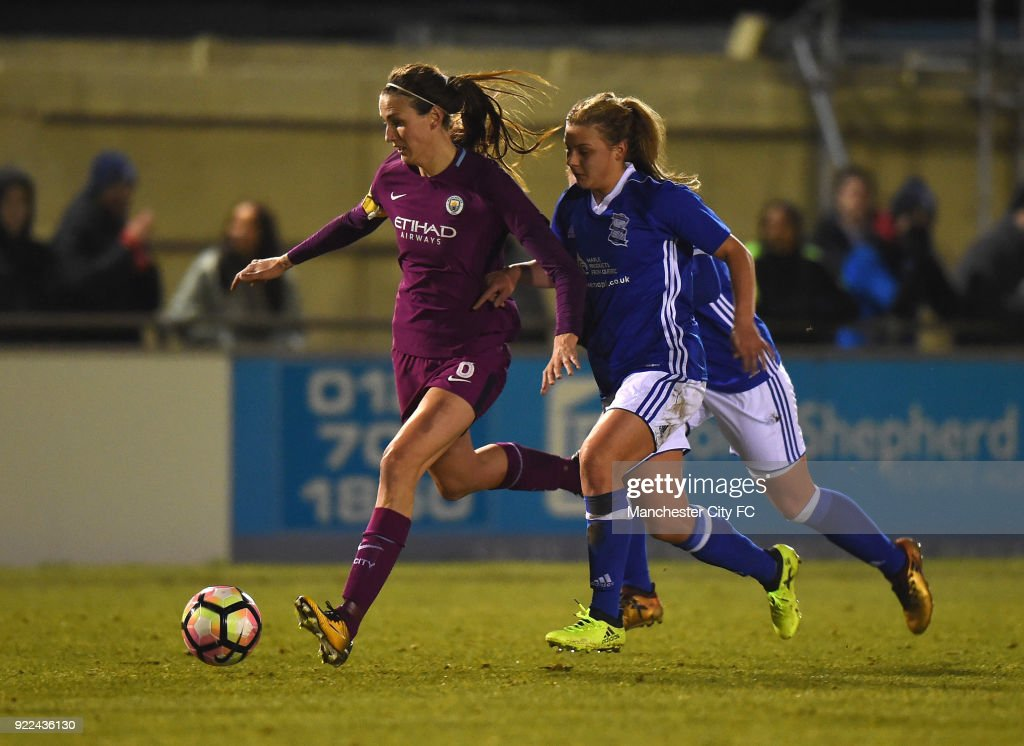 Jill Scott of Manchester City Women is tackled by Sarah Mayling of Birmingham City Ladies during the WSL match between Birmingham City Ladies and Manchester City Women at Damson Park on February 21, 2018 in Solihull, England.
