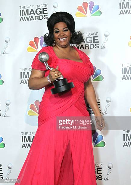 Jill Scott poses in the press room with her award for Outstanding Female Artist at the 43rd NAACP Image Awards held at The Shrine Auditorium on...