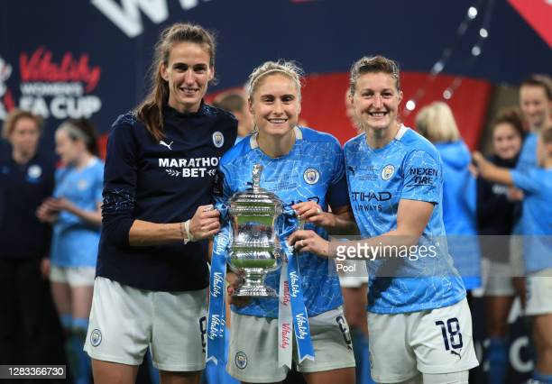 Jill Scott, Steph Houghton and Ellen White of Manchester City celebrate with the Vitality Women's FA Cup Trophy following their team's victory in the...