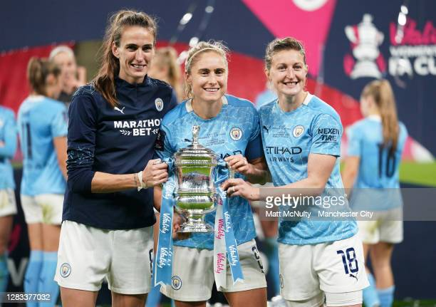 Jill Scott, Steph Houghton and Ellen White of Manchester City celebrate with the trophy during the Vitality Women's FA Cup Final match between...