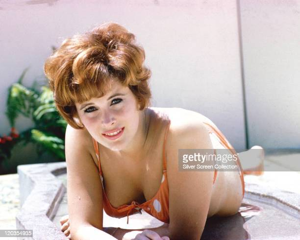 Jill St John US actress reclining on a sunlounger wearing an orange polka dot bikini circa 1960