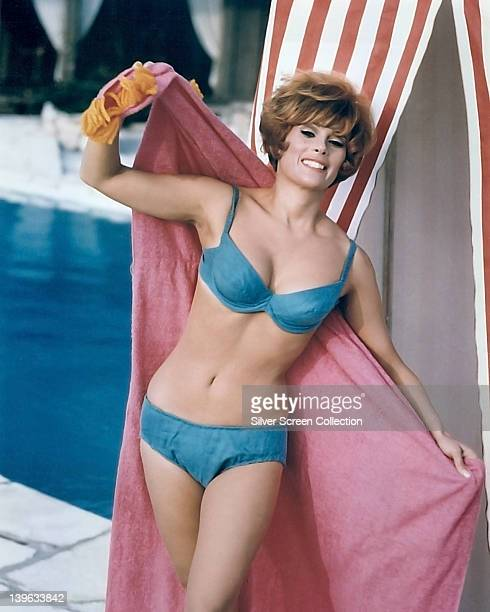 Jill St John US actress wearing an blue bikini and holding a pink towel circa 1960