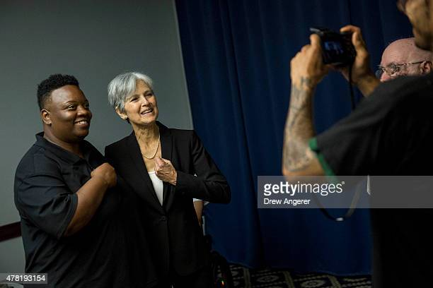 Jill Stein poses for a photo with a supporter after she announced that she will seek the Green Party's presidential nomination at the National Press...