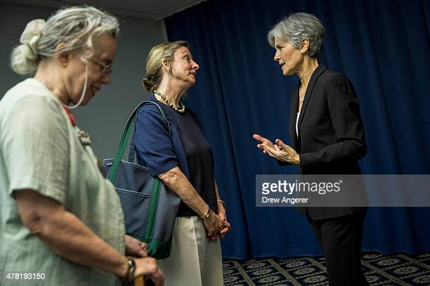 Jill Stein talks with supporters after she announced that she will seek the Green Party's presidential nomination at the National Press Club June 23...