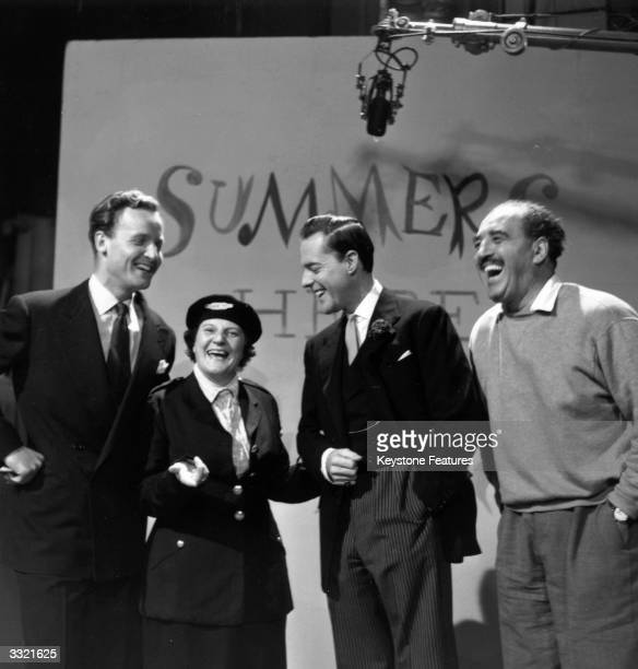Jill Summers enjoys a joke with Nicholas Parsons, Terence Alexander and Harry Lane in front of a backdrop for her show 'Summers Here' at ITV Studios,...