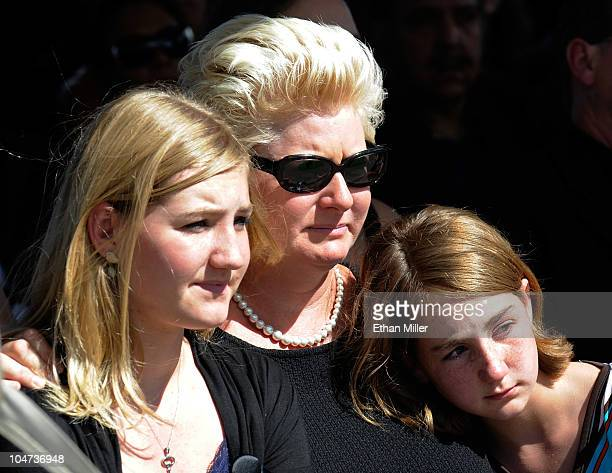 Jill Vandenberg comfort young mourners during the funeral for her late husband Tony Curtis at Palm Mortuary Cemetary October 4 2010 in Henderson...