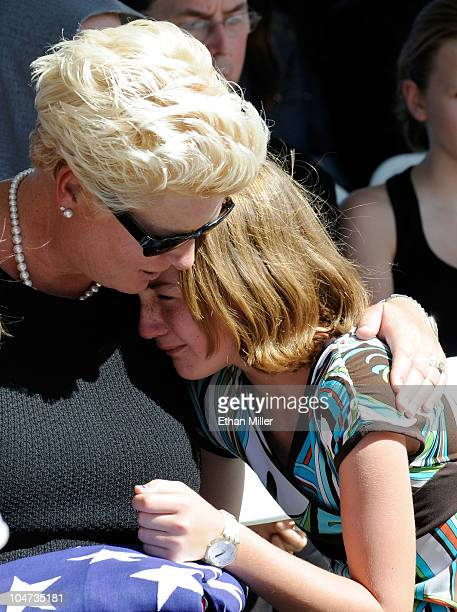 Jill Vandenberg comforts a young mourner during the funeral for her late husband Tony Curtis at Palm Mortuary Cemetary October 4 2010 in Henderson...