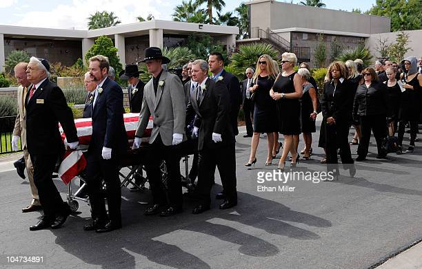 Jill Vandenberg follows pallbearers as they move her late husband Tony Curtis' coffin to his burial site at Palm Mortuary Cemetary October 4 2010 in...