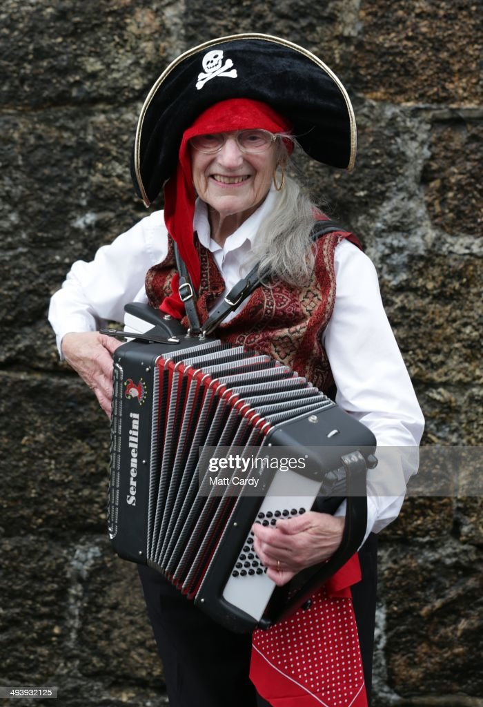 Jill Warden, dressed as a pirate, poses for a photograph, as
