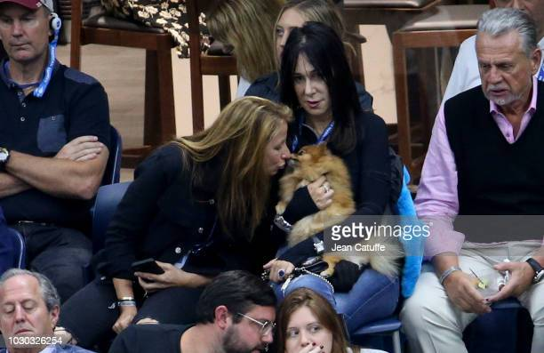 Jill Zarin kisses her dog during the men's final on day 14 of the 2018 tennis US Open on Arthur Ashe stadium at the USTA Billie Jean King National...