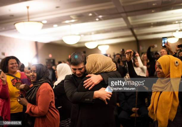 Jillia Pessenda embraces a fellow supporter of Minnesota Democratic Congressional Candidate Ilhan Omar at an election night party on November 6 2018...