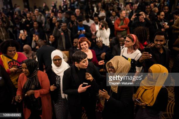 Jillia Pessenda reacts with a fellow supporter of Minnesota Democratic Congressional Candidate Ilhan Omar at an election night party on November 6...