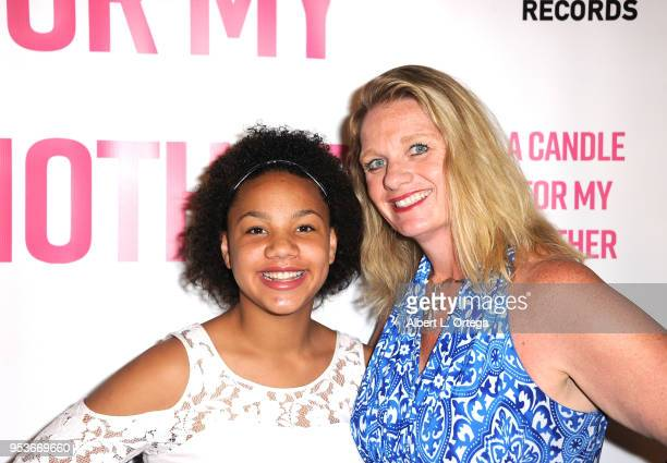 Jillian Estell poses with her mother Kristin Estell at a luncheon in honor of Mother's Day for the release of Pamela L Newton's 'A Candle For My...